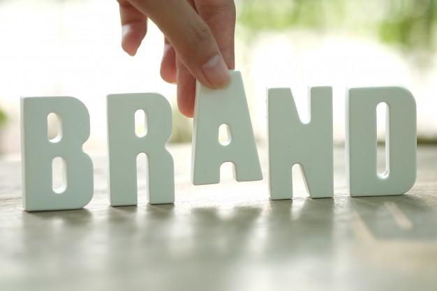 Hand arrange white letters brand Free Photo